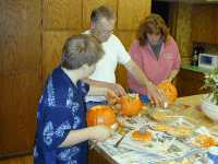 Bill and family carving pumkins!