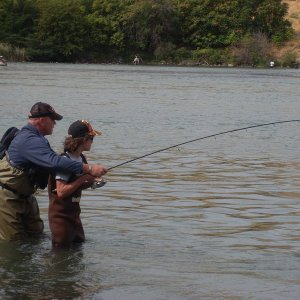helping a young angler